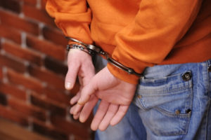 handcuffed behind back